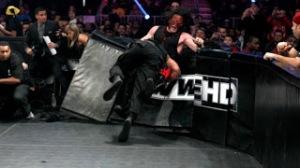 Roman-reign-speared-Kane-through-the-ringside-barrier-2